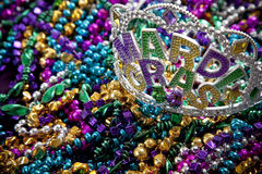 Mardi Gras crown. A colorful mardi gras crown or tiara lying on top of beads, holiday theme Royalty Free Stock Photo