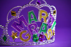 Mardi Gras crown on a purple background Royalty Free Stock Images