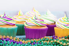 Mardi Gras cupcakes and beads stock photo