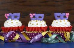 Mardi Gras cupcakes stock photos