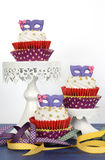 Mardi Gras cupcakes with purple mask toppers Stock Photography