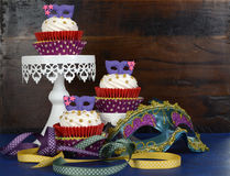 Mardi Gras cupcakes on stands royalty free stock photo