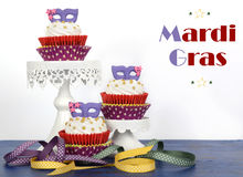 Mardi Gras cupcakes on white with text Stock Photos