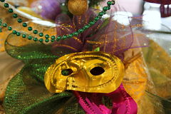 Mardi Gras. Decor colorfully embellished with masks, beads, and ribbons Royalty Free Stock Photo