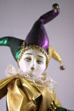 Mardi Gras Doll. Mardi Gras Porcelain Doll dressed up as a harlequin Royalty Free Stock Images