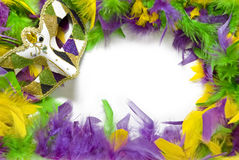 Mardi Gras Feather & Mask Frame. Field of white bordered or framed by feathers in traditional Mardi Gras colors (purple, green, and gold) and a Mardi Gras mask