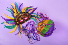 Mardi Gras feathered masks party hat beads. Mardi Gras still life feathered masks shiny party hat beads with copy space for text - part of series-also stock photos