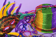 Mardi Gras feathered masks party hat beads. Mardi Gras still life feathered masks shiny party hat beads with copy space for text - part of series-also Royalty Free Stock Photos