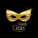 Mardi Gras golden carnival mask with ornaments for poster, greeting card, party invitation, banner or flyer on black background. Royalty Free Stock Photography