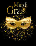 Mardi Gras golden carnival mask  for poster, greeting card, party invitation, banner or flyer on black background with golden sand Royalty Free Stock Image