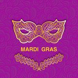 Mardi Gras golden icons on purple patterned background. Template design for greeting card or invitation with space for text. Stock Images