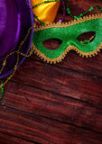 Mardi Gras: Green Mask And Purple Hat With Necklaces royalty free stock image