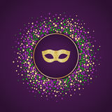 Mardi Gras holiday background. Round dotted frame with golden glitter mask. Stock Images