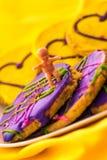 Mardi Gras kakor med behandla som ett barn Royaltyfri Foto