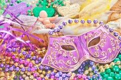 Mardi gras king cake. Mardi gras cake with beads