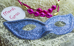 Mardi Gras label, carnival mask festive decorations on lace Royalty Free Stock Photos