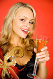 Mardi Gras: Laughing With A Glass Of Champagne Royalty Free Stock Photo