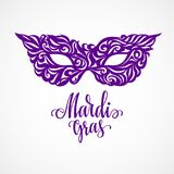 Mardi Gras lettering with carnival mask royalty free stock photography