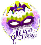 Mardi Gras lettering text. Purple carnival mask and clown cap Stock Photo
