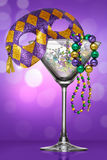 Mardi Gras Martini. Mardi Gras carnival style martini glass with beads and purple green gold mask masquerade celebration festivity New Orleans Louisiana royalty free illustration