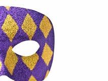 Mardi Gras Mask. Purple and gold glittered Mardi Gras mask on white Royalty Free Stock Image