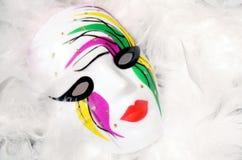 Mardi Gras Mask. Painted Mardi Gras mask on white feathers