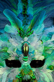 Mardi Gras mask. Feathered turquoise and green Mardi Gras mask