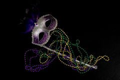 Mardi Gras Mask. A Mardi Gras or constume party mask with beads on a black background