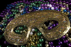 Mardi gras mask. Sitting on top of a pile of beads Royalty Free Stock Image