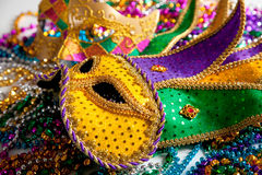 Mardi Gras mask background. A group of two mardi gras mask and beads