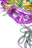 Mardi Gras mask and beads. Masquerade party supplies with copyspace