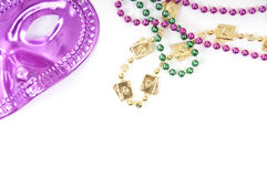 Mardi Gras mask and beads Royalty Free Stock Photos