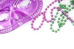 Mardi Gras mask and beads Royalty Free Stock Photo