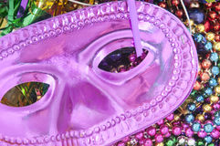 Mardi Gras mask and beads Royalty Free Stock Photography