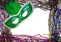 Mardi Gras Mask & Beads. Green Mardi Gras mask with colorful Mardi Gras beads on white background Stock Image