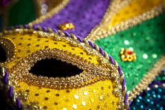 Mardi Gras Mask and Beads. A group of mardi gras beads an mask with copy space