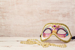 Mardi gras mask and beads for party Royalty Free Stock Images