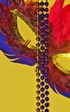 Mardi Gras mask and beads. stock image