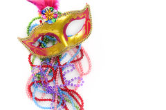Mardi gras mask and beads on white background.Top view. Mardi gras mask and beads on white background