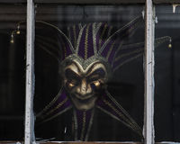 Mardi Gras Mask - Color. Color image of a Mardi Gra mask in the window - French Quarter of New Orleans, Louisiana Royalty Free Stock Photos