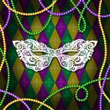 Mardi Gras mask with feathers on a colored bead frame. Vector illustration EPS10.  vector illustration