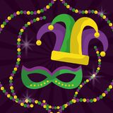 Mardi gras mask with feathers and jester hat beads glitter royalty free stock photography