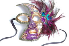 Mardi Gras mask female. Mardi Gras mask from New Orleans with black ribbon straps and open eye-holes, musical notes and staff decorations, and gold and purple royalty free stock photo