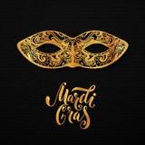 Mardi gras mask illustration. Vector golden type at black paper background. Masquerade invitation design. Royalty Free Stock Photography