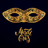 Mardi gras mask illustration. Vector golden type at dark blue background. Masquerade invitation design.  Royalty Free Stock Photo