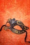 Mardi Gras mask on orange background. Stock Photography