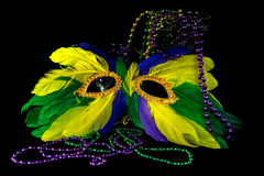 Mardi Gras mask and party beads Royalty Free Stock Images