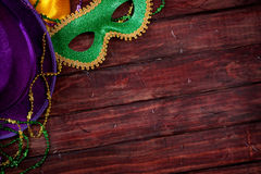 Mardi Gras: Mask And Purple Hat With Wood Background stock image