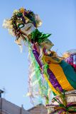 Mardi Gras Mask. A resident of the French Quarter in New Orleans decorates their home with Mardi Grad colors