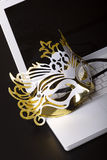 Mardi Gras mask on a white laptop. Stock Images